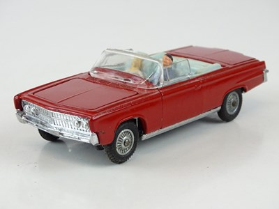 Lot 10 - A CORGI 246 Chrysler Imperial in red with pale...