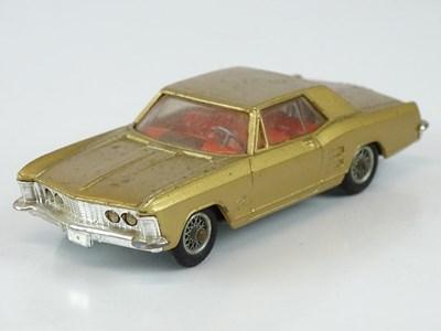 Lot 12 - A CORGI 245 Buick Riviera in metallic gold...