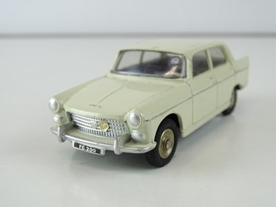 Lot 15 - A FRENCH DINKY 553 Peugeot 404 in cream with...