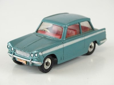 Lot 16 - A DINKY 134 Triumph Vitesse in blue with red...