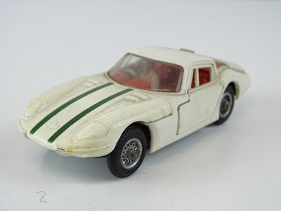 Lot 21 - A CORGI 324 Marcos 1800 GT in white with green...