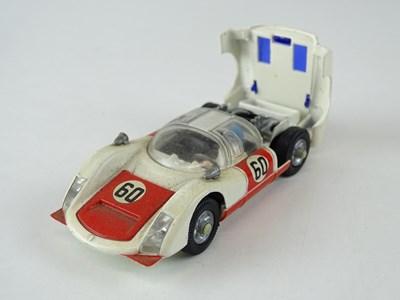 Lot 23 - A CORGI 330 Porsche Carrera 6 numbered 60 - G...