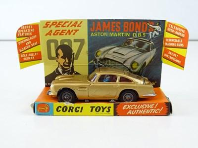 Lot 33 - A CORGI 261 James Bond's Aston Martin in gold...