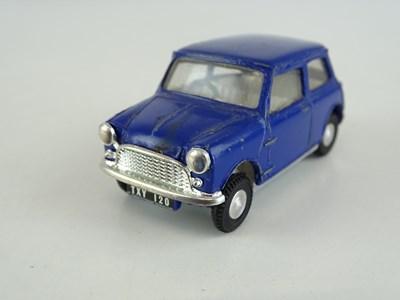 Lot 34 - A TRI-ANG SPOT-ON 211 Austin 7 Mini in dark...