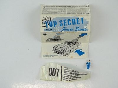 Lot 37 - A CORGI 261 James Bond's Aston Martin in gold...