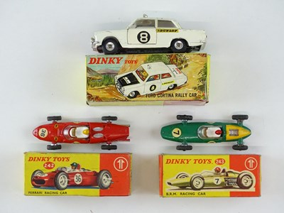 Lot 41 - A group of DINKY racing cars comprising a 212...
