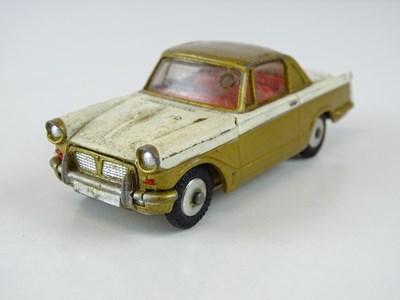 Lot 9 - A CORGI 231 Triumph Herald Coupe in gold/white...