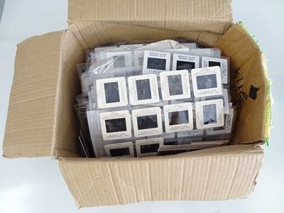 Lot 40 - A large box of 35mm film slides from a large...