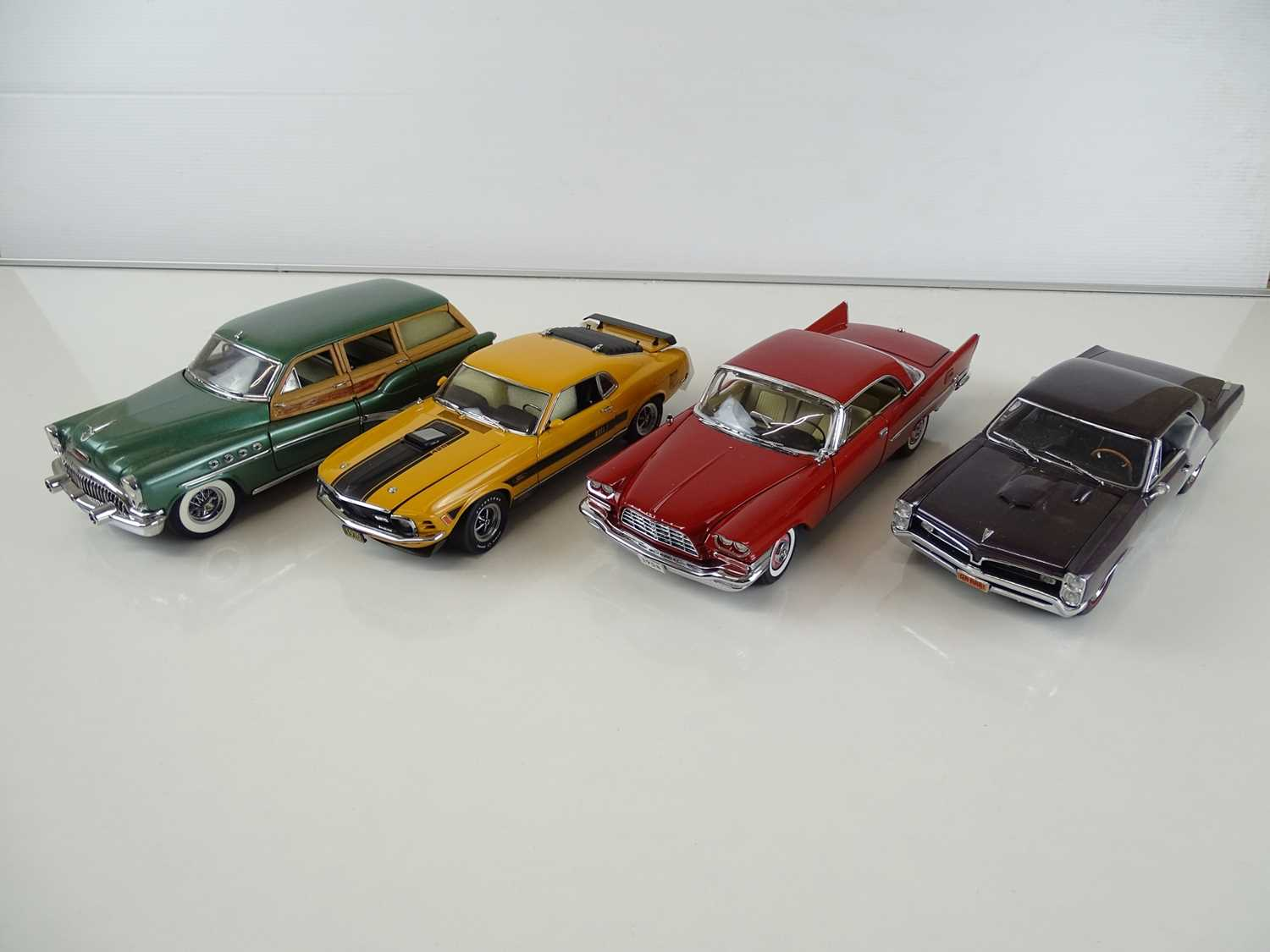 Lot 150 - A group of diecast cars in 1:24 Scale by...