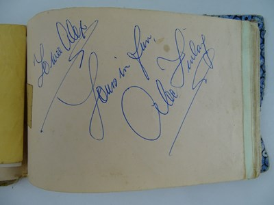Lot 141 - A well worn autograph book with signatures to...