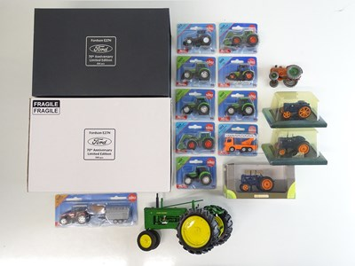 Lot 13 - A group of diecast tractor models to include a...