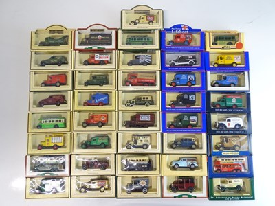 Lot 27 - A large tray of diecast vans, buses etc mostly...