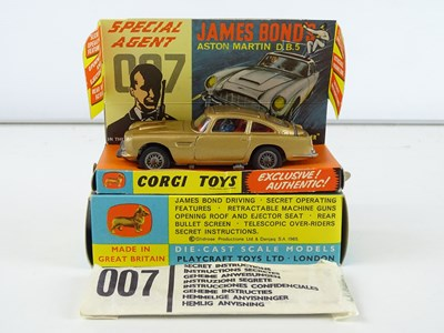 Lot 79 - A CORGI Toys 261 James Bond's Aston Martin in...