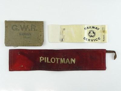 Lot 40 - A pair of armbands comprising: a Pilotman band...