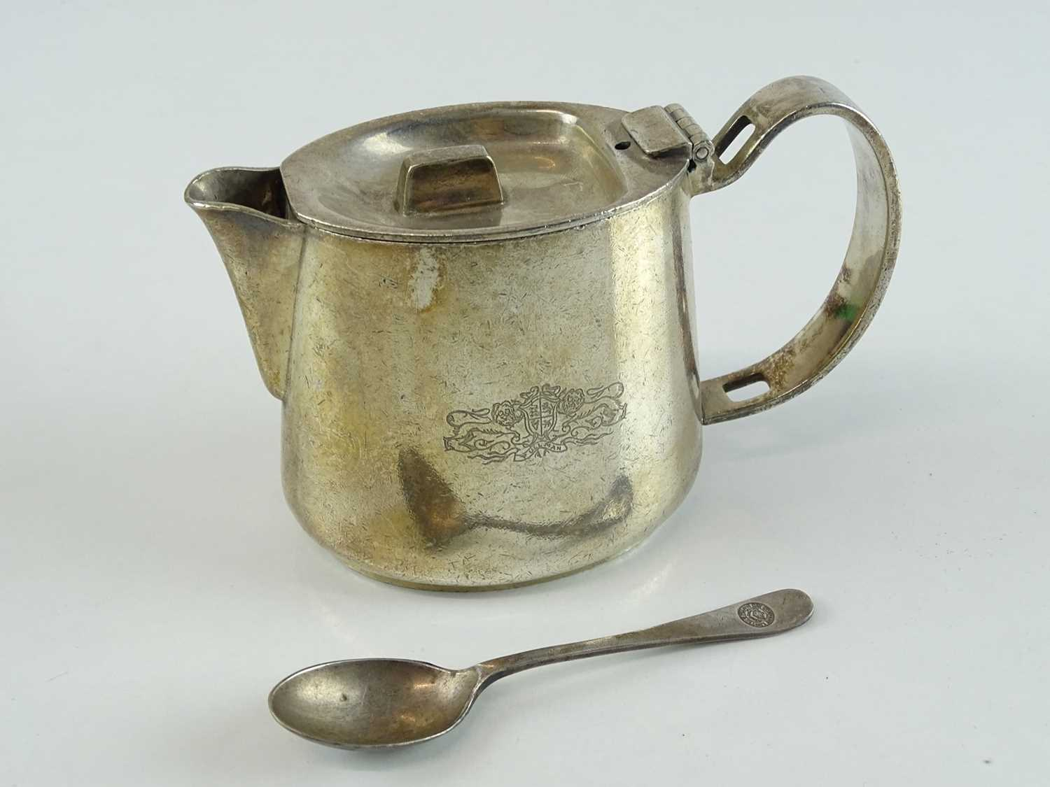 """Lot 48 - A silver plate tea/hot water pot (4"""" tall) and..."""