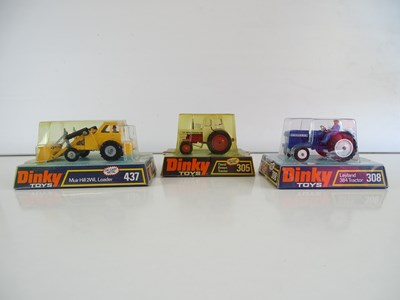 Lot 16 - A group of DINKY tractors comprising 305, 308...