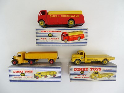 Lot 17 - A pair of DINKY lorries comprising 409 and 933...