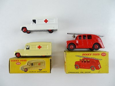 Lot 29 - A pair of DINKY 253 Daimler Ambulances in...