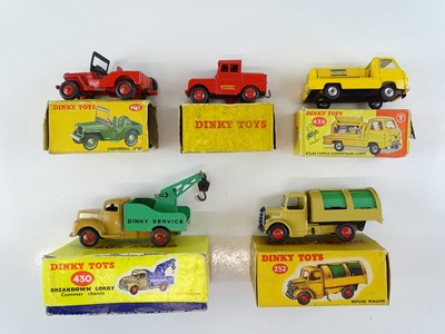 Lot 40 - A mixed group of DINKY vans and trucks - G in...