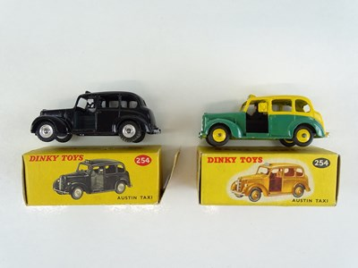 Lot 41 - A pair of DINKY 254 Austin Taxis in black and...