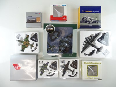 Lot 8 - A mixed group of diecast airplanes in various...